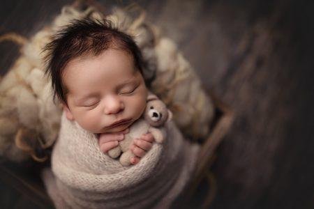 newborn baby with bear